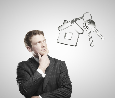 businessman thiking and looking on keys photo