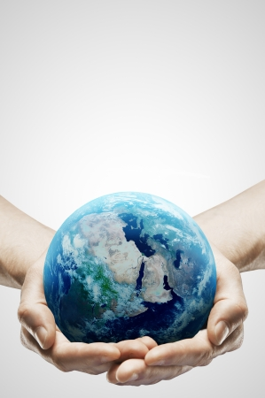 world globe map: hands holding earth on gray background