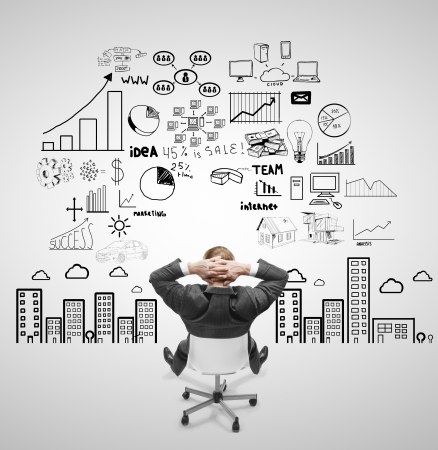 businnessman sitting on chair and looking at business strategy photo