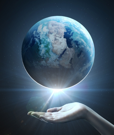 human geography: hand holding earth, space concept