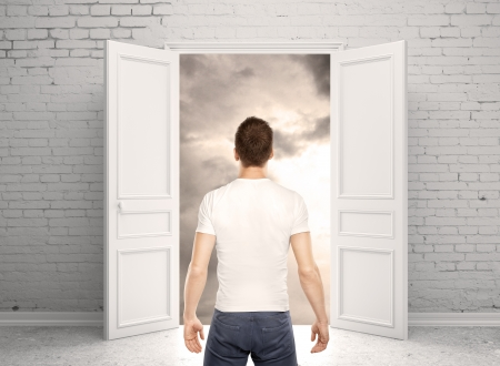 man standing back and opened door photo
