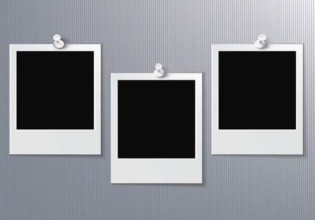 three blank photo pinned on gray wall