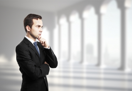 thinking businessman in office with column Stock Photo - 20682945