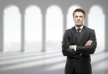 standing stones: businessman in suit in office