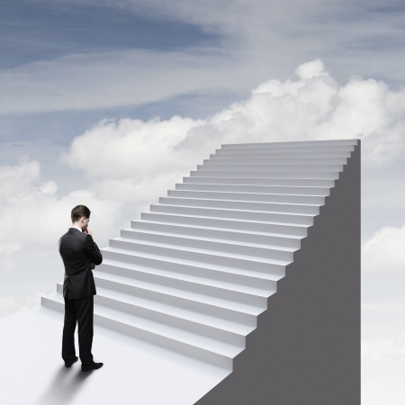 difficult journey: thinking businessman standing near ladder in sky