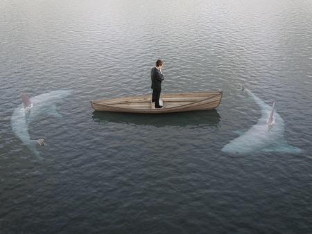 success concept: businessman thinking  boat with sharks around him