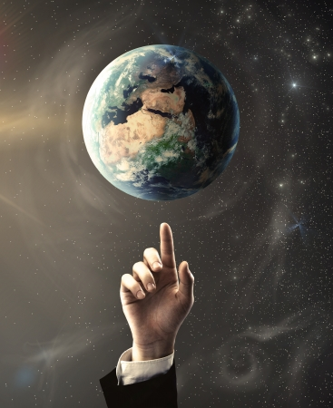 hand pointing at earth, space concept photo