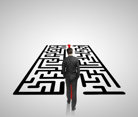 intricacy: businessman walking on a labirinth
