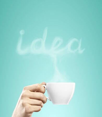 cup of coffee in hand, idea concept photo