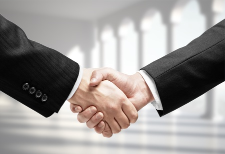 business handshake on a column background photo