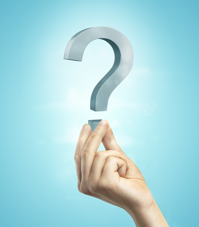 question mark in hand on a blue background Stock Photo - 20682976
