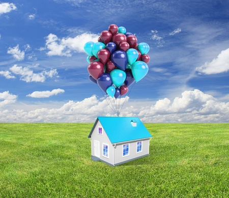cottage with baloons on nature background photo