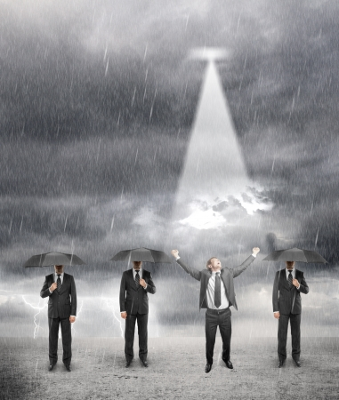 businessman standing: three businessman standing with umbrella and one happiness businessman in rainy weather