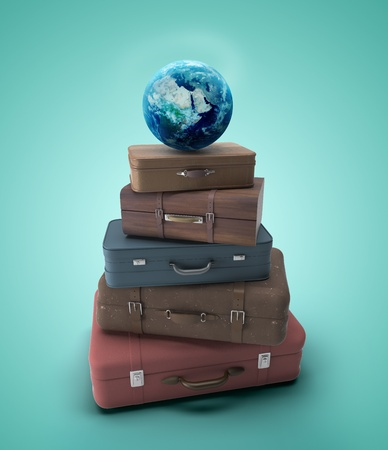 travel bags and earth  on a blue background photo