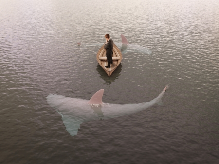 man thinking  boat with sharks around him photo