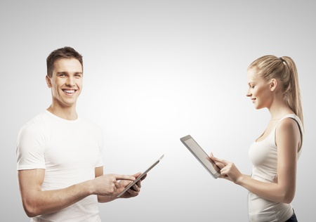 happines: man and woman holding tablet on gray Stock Photo