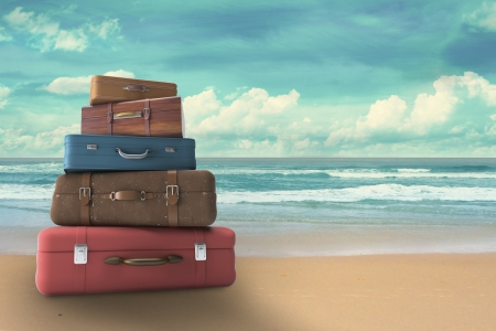 travel destination: bags on beach, travel concept Stock Photo