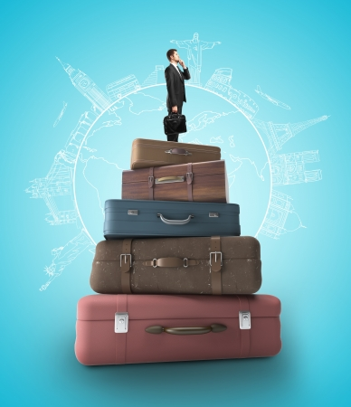 businessman standing near stack of books, travel concept Stock Photo - 20984007