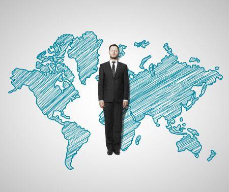 businessman lies on world map photo