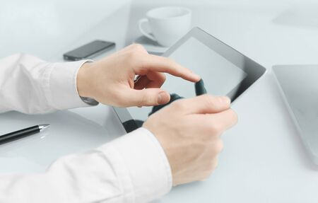 high resolution hand touching touch pad photo