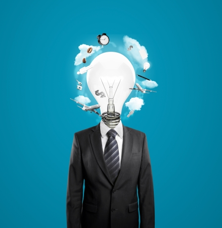 businessman with lightbulb instead of head on blue background photo