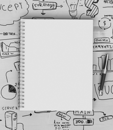 graph paper: note book on a wooden table with drawing concept Stock Photo