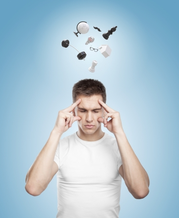man with mix of items above his head photo