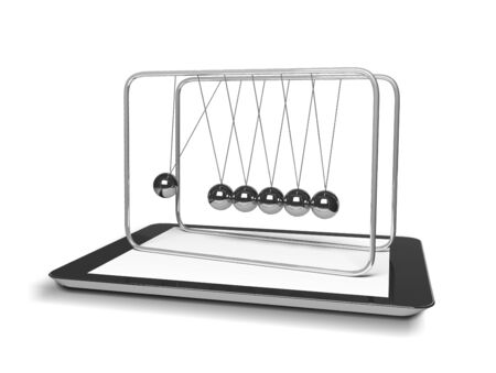 tablet and newton's cradle on a white background photo