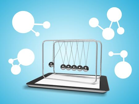 touch pad and newtons cradle on a blue background photo