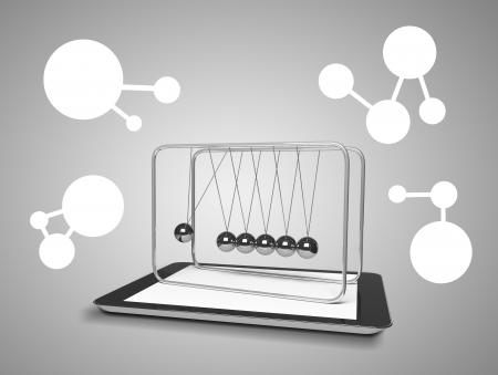 touch pad and newtons cradle on a gray background photo