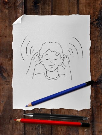 drawing boy: paper with drawing boy on wooden table and pen Stock Photo