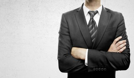 folded hands: businessman standing  with hands  folded
