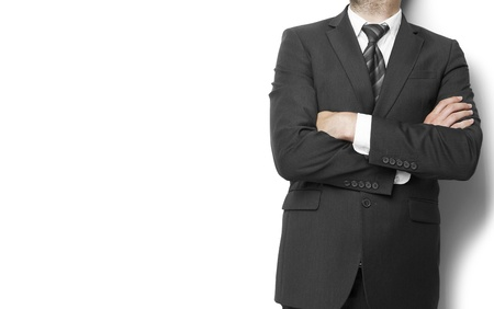 businessman standing  with hands  folded on wall background Stock Photo - 21275636
