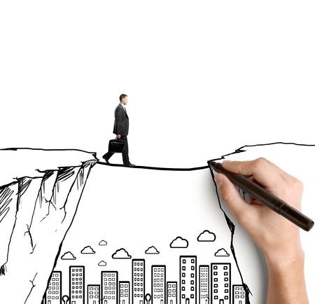 ontwikkeling: hand tekening zakenman op rots