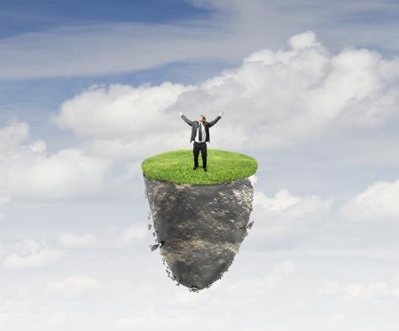 mountin: happy young man on flying island