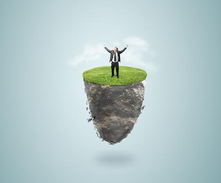 mountin: happy businessman on flying island