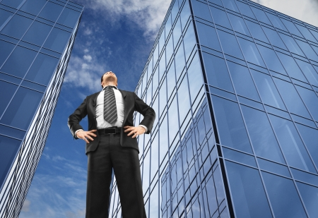 office buildings: businessman in front of office buildings