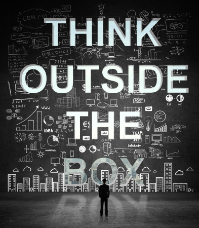 businessman looking at think outside the box in concrete wall with drawing concept Stock Photo - 21409373