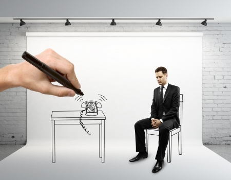 designer chair: young man sitting on drawing chair Stock Photo