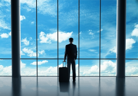 businessman in airport with luggage and looking in sky Stock Photo - 21349561