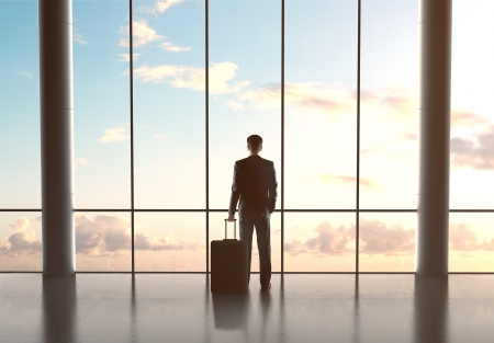 man in airport with luggage and looking in sky Stock Photo - 21349531