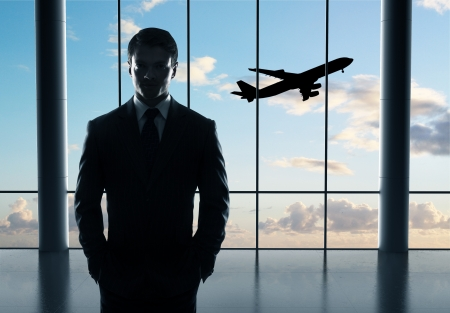 businessman in airport and airplane in sky Stock Photo - 21349485