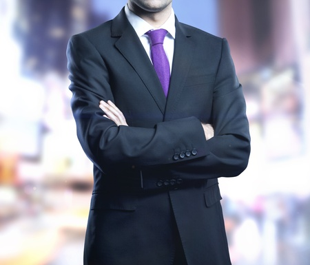 businessman standing in suit and city onbackground Stock Photo - 21349484
