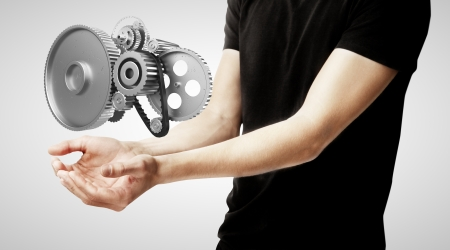 boy holding metal gears and cogs wheels photo