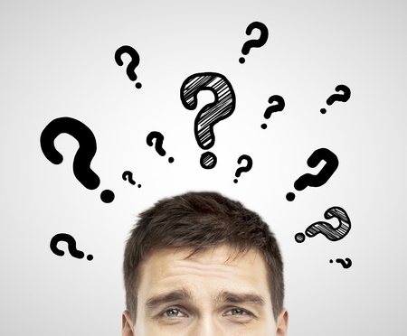 businessman with question mark  on a white background photo