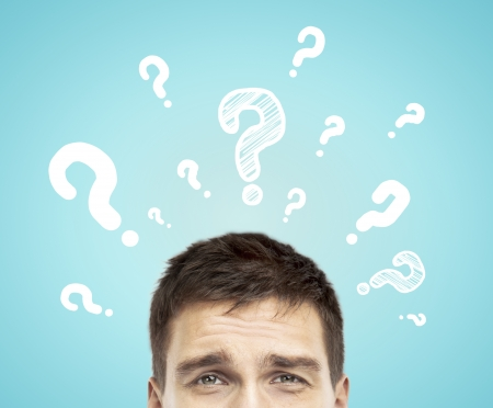 businessman with question mark  on a blue background photo