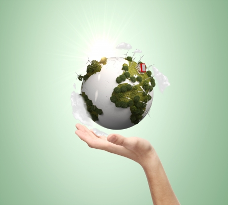 hand holding earth on green background Stock Photo