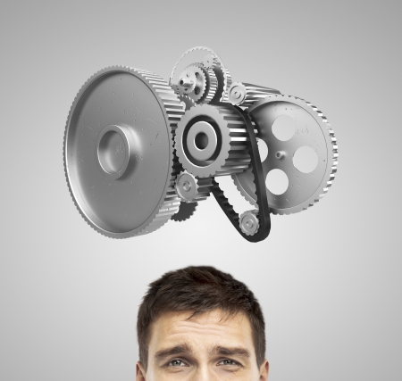 rack wheel: businessman thinking with gears over head Stock Photo