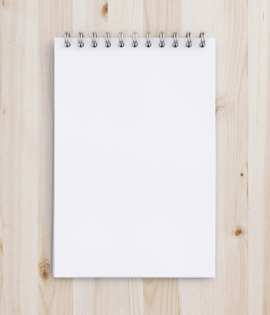 notebook on a wooden table Stock Photo