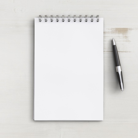 note pad and pen: blank notebook on a white wooden table Stock Photo